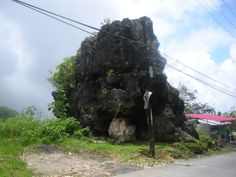 Stone boulders are patrols along Asin Rd