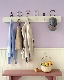 Vintage letters are a clever way to designate hooks on a coat rack. Try to match the style of each letter to the personality of its owner.
