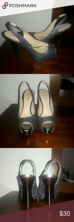 """GUESS Sparkling Pewter Peeptoe Slingbacks. Statement shoes.  Add some sparkle to any outfit. Great condition.  Chic and comfortable.   Color: Pewter Size: 7.5 Heel Height: 4.5"""" Style: Peeptoe slingback   These do run a bit small. Definitely fit a 7 & possibly a 6.5.  I ship by the next day; same day if possible. Thanks for Poshing ! Guess Shoes"""