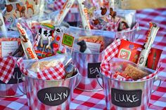 "Farm theme birthday party favors - chalkboard pail filled with farm stickers, Cow Tale, plastic farm animal and ""hay bale"" rice krispy treat for my Nena Farm Party Favors, Farm Themed Party, Barnyard Party, Birthday Party Favors, First Birthday Parties, Birthday Ideas, Cowboy Party Favors, Farm Party Kids, Farm Party Decorations"