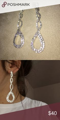 Dangly diamond earrings Long, silver diamond earrings. Worn once for prom when I was in high school! Jewelry Earrings