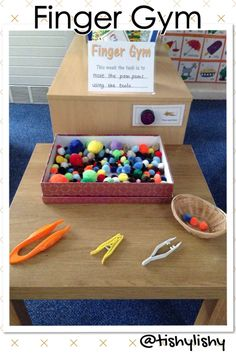 Finger Gym challenge area - transporting pom poms with 3 different tools.
