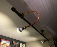 Following how well my lighted pipe-supported shelves turned out, I wanted to do a similar style light fixture for lighting album artwork on my office ...
