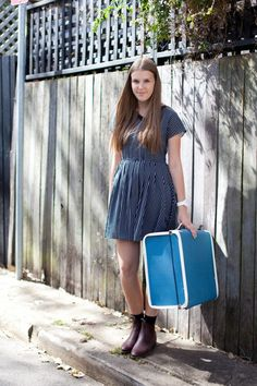 She wears a vintage dress and carries a vintage suitcase. #outfit #socks
