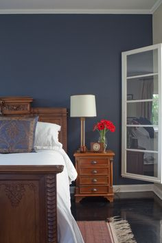 Blue — it's a versatile color that in its darkest hues is dramatic and moody. It can be bold, uplifting and energizing. It can mix with other hues to create stunning teals, turquoises, dusty bluish grays and more. Barely there, it's a hint of color that soothes and softens. Want to pick a blue for a wall or furniture paint project this weekend and know it'll look amazing? Check out these 20 real-life examples of blues used in house tours — including paint names!