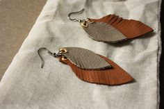 Leather Feather Earrings. Or just leather scrap earrings. Great use for those left-over leather scraps from making moccasins!