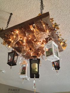 Pallet chandelier. I stuffed some printed burlap, added pip berries, greenery and lights on top. All the lanterns were on clearance at target.