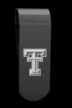 Brushed Black Stainless Steel Texas Tech Money Clip with Laser Etched 'TT' Logo in the Center. This Money Clip is a Great Way to Show Your School Spirit! This Item Is Officially Licensed. This Item Comes with a Cushioned Jewelry Box and Velvet Pouch for Safe Storage. The Indicia Featured On This Product Are Registered Trademarks Of Each Respective College Or University. Length: 71.10 mm Width: 25.40 mm Depth: 11.45 to .6 mm  SKU Code: GM55Z0011  Price: $50.00