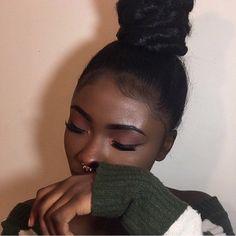 dark skin, bun, and make up goals image