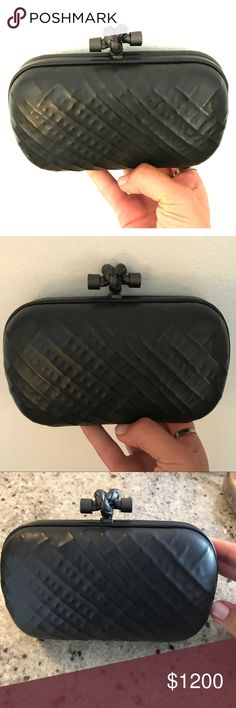 "Bottega Veneta Leather Knot Black Clutch Authentic Bottega Veneta letstger ""Knot"" clutch. Beautiful soft leather black bag with gunmetal- tone hardware with knot clasp top closure. Interior features suede lining embossed with logo. The bag is so elegant and has the perfect amount of modern edge! Bottega Veneta Bags Clutches & Wristlets"