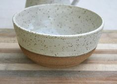 rustic cereal bowl, speckled pottery, breakfast bowl, minimal matte, stoneware bowl, rustic dinnerware, white earthy dish, white speckled These rustic wheel thrown cereal/breakfast bowls are part of my new collection of functional ceramics designed to be sturdy for everyday use but with mindful creative elements to engage the user. The true beauty of the raw stoneware clay is emphasized against the matt off white speckled glaze which has an egg shell look & feel. I added some horizon...