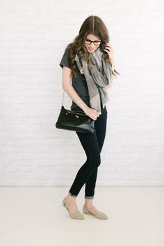 gray scarf + gray tee + skinny jeans + black bag + gray d'orsay flats