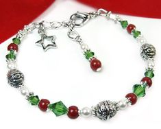 #bmecountdown Tis the season for lovely holiday jewelry, and this cheerful red coral, green crystal, and white pearl handmade adjustable Christmas bracelet