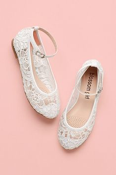 Pair of white lacey flower girl shoes