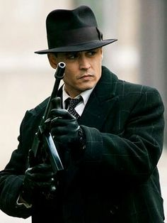Johnny Depp in Public Enemies, if you were looking at what I were looking at, you'd be in a hurry too.
