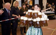 Octoberfest in Munich .....waitress competition in carrying mugs of beer...one is 1L.....she is holding 15 mugs in her hands ....10 in each hand + 5 on top....some women can hold up to 20 mugs