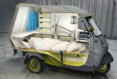"Piaggio APE 50 (pronounced ""Awe-Pay"") as Fully-Furnished Bufalino camper for that Home Away From Home ... concept by German engineer Cornelius Comanns and is based on a three wheeled vehicle and includes a bed, two seats, a cooking zone + refrigerator."