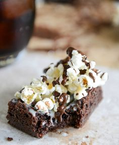 sinful... but popcorn's a whole grain right?! Buttered Popcorn Crunch Brownies I howsweeteats.com