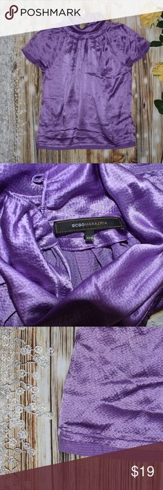 """BCBGMaxAzria 100% Silk Pleated Purple Blouse BCBG MAXAZRIA Size XXS (but it might fit S also) Approx. chest: 21.5"""" (laid flat completely extended) Lenght: 25"""" 100% Silk  Pleated Neckline Pull-over but buttons around the neck Folding turtle neck Purple Lilac  Pre-loved No stains o tears BCBGMaxAzria Tops Blouses"""