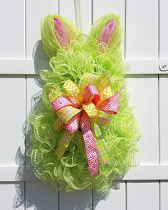 Welcome the Easter Bunny with this festive wreath on your front door! The wreath is created using a spring green snowball deco mesh on a bunny frame. The bow is created with pink, yellow, and green coordinating ribbons. This measures approximately 30 long x 22 wide. All of my wreaths are handmade by me! Please feel free to contact me with any questions about this wreath. Also, if you would like a similar wreath more custom designed to your decor, I can do that too.  To purchase, just click…