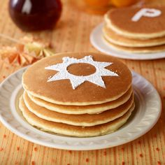 Monogram your meal. Use stencils with various shapes and letters and sieve powdered sugar over the stencil. Now there's no arguing over which stack is yours.