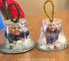 "These adorable snow globe cup ornaments were made by Krista Boyer-Clark and they are the perfect thing to make for Christmas gifts! Supplies Needed: Punch cups Photos Scrapbook paper Fake snow Hot glue Pipe cleaner Directions: ""I used punch cups from the dollar tree. Printed their picture and cut it out. Glued it to … Christmas Themes, Christmas 2017, Christmas Gifts For Parents, Christmas Ornaments To Make, Preschool Christmas, Christmas Holidays, Christmas Activities, Christmas Crafts For Kids, Kids Christmas"