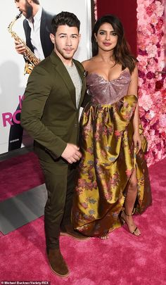 In the spotlight: Priyanka Chopra, 36, and her husband Nick Jonas, 26, look as loved-up as ever as they dazzled while strutting their stuff on the red carpet at the LA premiere for Rebel Wilson 's new movie Isn't It Romantic on Monday