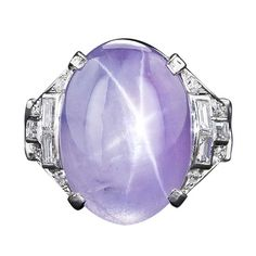 A colour that suits all skin tones - Art deco lavender star sapphire ring in platinum with diamonds. (=)