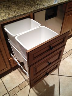Set of kitchen drawers retro-fitted into a garbage pull-out... no need for a custom build just buy the kit at lowes!