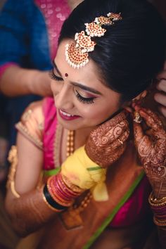 Maang Tikka - Layered Maang Tikka | WedMeGood | South Indian Bride Wearing a Meenakari Maang Tikka with Pearl Droplets #wedmegood #indianbride #indianwedding #southindianbride #maangtikka #meeenakari #maangtikka #layered #pearls