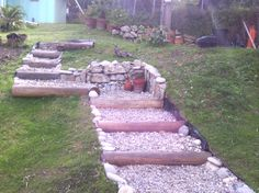 Steps created with logs and beach pebbles