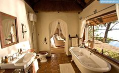 Relaxing bathtime with stunning views while glamping in Zambia