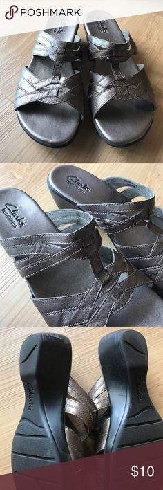 Clark's sandals size 6.5 Clark's sandals in a bronze pewter color... normal wear on heels..leather in excellent condition...size 6.5 Clarks Shoes Sandals