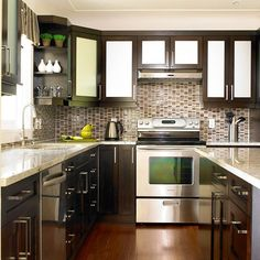 Like this look, but probably too dark for our kitchen, unless we installed a lot of lights.. The corner shelf by the window is neat.
