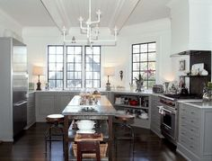 Gorgeous kitchen. Notice the open cabinet. Why don't we see more of these?