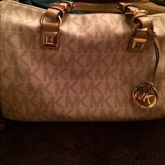 Great condition MK bag Beautiful winter white with MK and tan handles.   In perfect condition.  Looks brand new. Michael Kors Bags