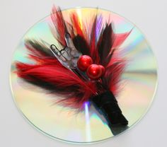 Rock and Roll Feather Boutonniere. $14.95, via Etsy.