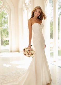 Strapless wedding dress with form fitting, trumpet silhouette {6236, Stella York}