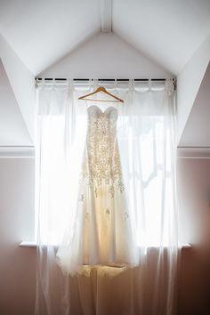 Stunning Stella York dress. View the full wedding here: http://thedailywedding.com/2016/08/08/lovely-lakeside-wedding-cassie-paul/