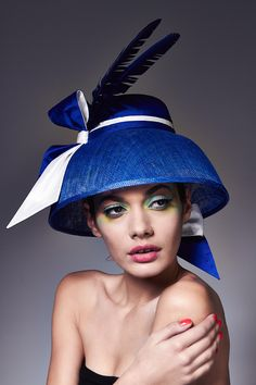 Charlotte | Label: Lisa Tan Millinery | Spring/Summer 2014 | Dome-shaped hat featuring a silk-covered crown and sinamay brim, trimmed with a tied silk ribbon, silk head ties and two split turkey plumes. Shown in cobalt/white colour combination