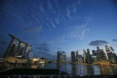 A view of Singapore's skyline is seen in this March 2, 2016 file photo. The Economist Intelligence Unit (EIU) on March 10, 2016 ranked Singapore as the world's most expensive city to live in for the third consecutive year. REUTERS/Edgar Su