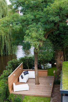 ≡ outdoors, patio, I would add built in seating to this, landscape architecture, deck around a tree, build around a tree