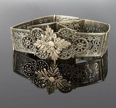Algeria - Aures | Belt; thirteen hinged and engraved silver plates, with flower buckle | 372€ ~ sold (May '15):