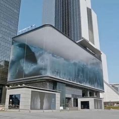 It's a three-dimensional illusion of a wave washing around inside a big glass cube looking over a heavily trafficked section of It is showing on a 90 meter wide by 20 meter tall direct view LED board. creative work by the Seoul digital shop d'strict. Futuristic Architecture, Amazing Architecture, Architecture Design, Public Architecture, Futuristic Art, Chinese Architecture, Layered Architecture, Fashion Architecture, Creative Architecture