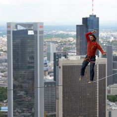 Walk the Line: A professional slackliner walked along a cable during the Frankfurt Skyscraper Festival in Germany.