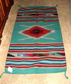 """A quality woven wool rug with a southwestern / Native American design. 32x64"""" with tassled corners. Durable.  Pretty enough to hang on your wall as a tapestry. $79.95 #homedecor #rugs #southwestern #throwrug #nativeamerican"""