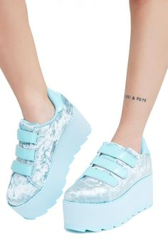 Y.R.U. Lala Velvet Velcro Platform Sneakers will take ya sky high. These cute af velvet platforms have supa thikk soles and velcro closures across the top.