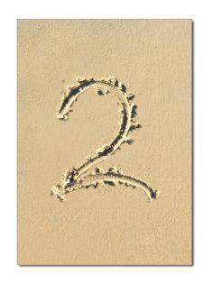 Beach Theme Wedding Reception Table Numbers – Written in the Sand. Perfect for beach themed celebrations.