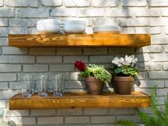 Floating+shelves+in+natural+wood+are+an+eye+catching+accent+in+a+new+outdoor+dining+space.