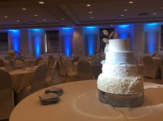 blue uplighting & cake spot lights from the ceiling
